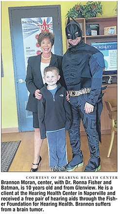 Photo of Hearing Health Center Dr. Ronna Fisher of Hearing Health Center, her patient and Batman