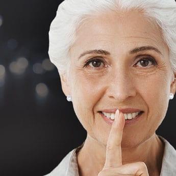 Shh-Woman-HearingHealthCenter